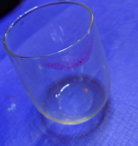 a glass with a lip print