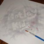 Motley kids in wax resist writing